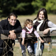 Family enjoying a walk in the countryside — Stock Photo #7418172