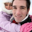 Father and daughter at ski — Stock Photo