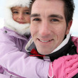 Stock Photo: Father and daughter at ski