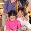 Grandmother, mother and daughter at Christmas — Stock Photo