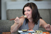 Woman eating Japanese food — Stock Photo