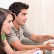 Portrait of teenagers playing video game — Stock Photo