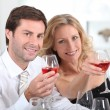 Couple holding wine glasses — Stock Photo
