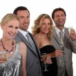 Foto Stock: Two couples celebrating