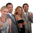 Two couples celebrating — Stock Photo