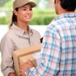 Stock Photo: Female courier delivering package