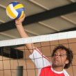 Volleyball player pushing ball over net — Stock Photo