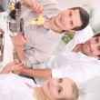 Stock Photo: Friends eating raclette