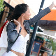 Woman holding up shopping bag — Stock Photo #7427985