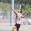 Stock Photo: Tennis player serving
