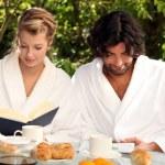 Couple having breakfast outside — Stock Photo #7429230