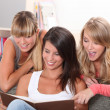 Young women looking at photos — Stock Photo