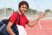 Tennis player stood by outdoor court — Stock Photo
