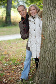 Mature couple out for an autumn stroll — Stock Photo