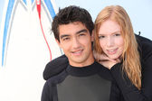 Two young surfers in wetsuits — Stock Photo