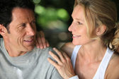 Mature fit couple exercising together in the countryside — Stock Photo
