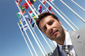 Businessman with flags. — Stock Photo