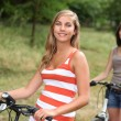 Adolescent girls riding their bikes — Stock Photo