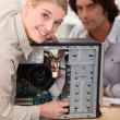 Couple attempting to repair computer - Stock Photo