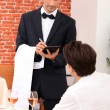 A waiter working at restaurant — Stock Photo