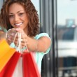 Happy woman holding shopping bags — Stock Photo #7432188
