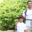 Father and son walking in the park — Stock Photo #7432477