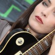 Stock Photo: Brunette with electric guitar