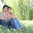 Couple sat in park — Stock Photo