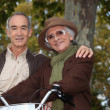 Stock Photo: Elderly couple on a bike ride in the forest