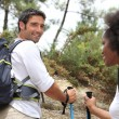 Couple hiking in the mountains — Stock Photo