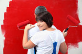 A man and his wife painting a wall — Stock Photo