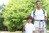 Father and son walking in the park — Stock Photo