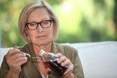 Grandmother pouring syrup — Zdjęcie stockowe