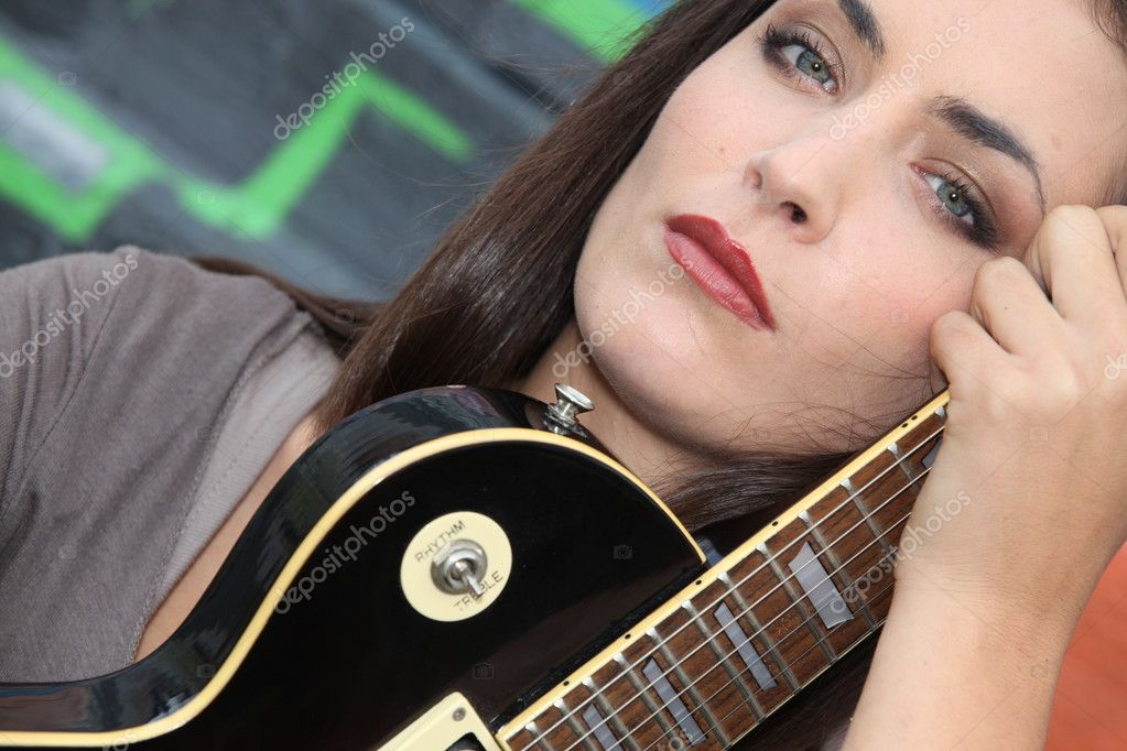 Brunette with electric guitar — Stock Photo #7433635
