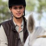 Young girl riding a horse — Stock Photo #7448635