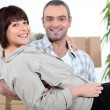 Mcarrying his wife over threshold — Stock Photo #7449661