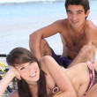 Young couple on the beach — Stock Photo #7450145