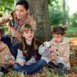 Children blowing bubbles — Stock Photo #7451783