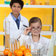 Royalty-Free Stock Photo: Children doing chemistry experiments with orange juice