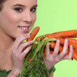 Portrait of fine-looking girl posing with carrots — Stock Photo #7455214