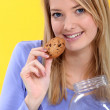 Woman eating a cookie — Stock Photo