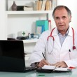 Doctor prescribing medication — Stock Photo #7455977