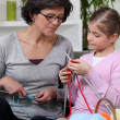 Mother and daughter knitting — Stock Photo #7456152