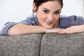 Nice brunette posing on her couch. — Stock Photo