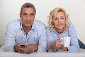 A middle age couple lying in bed. — Stock Photo