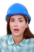 A scared female construction worker. — Stock Photo