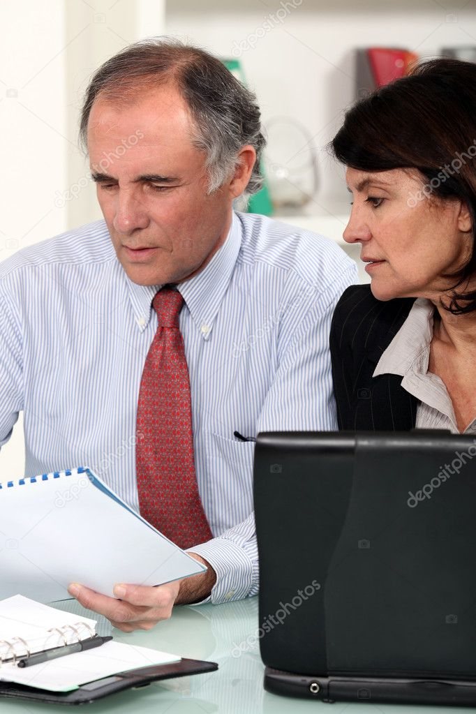 Business couple working at a desk — Stock Photo #7455879