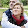 Mature couple in the countryside — Stock Photo