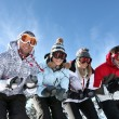 Four friends on skiing holiday — Stock Photo