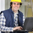 Royalty-Free Stock Photo: Builder sat with laptop
